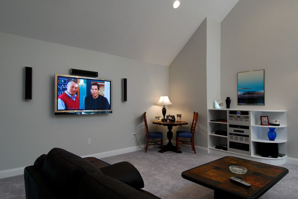 Media Room with wall mounted TV and surround sound
